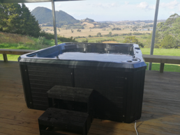 Platinum Plug-In Spa black marble with black surrounds, customer photo, auckland location